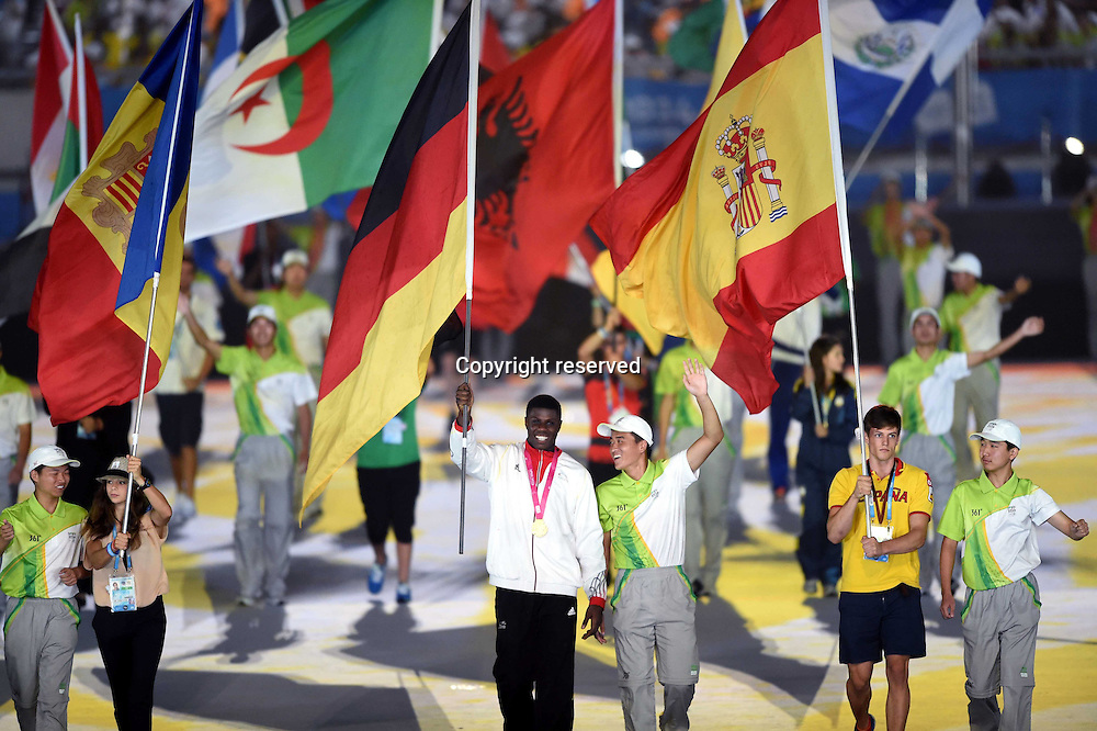28.08,2014. Nanjing, China. Delegation flags enter the stadium during the closing ceremony of Nanjing 2014 Youth Olympic Games in Nanjing, capital of east Chinas Jiangsu Province, Aug. 28, 2014.