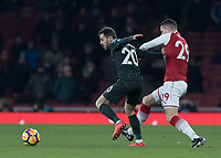 Football - 2017 / 2018 Premier League - Arsenal vs. Manchester City<br /> <br /> Granit Xhaka (Arsenal FC) has a hold of Bernardo Silva (Manchester City) to prevent his run at The Emirates.<br /> <br /> COLORSPORT/DANIEL BEARHAM