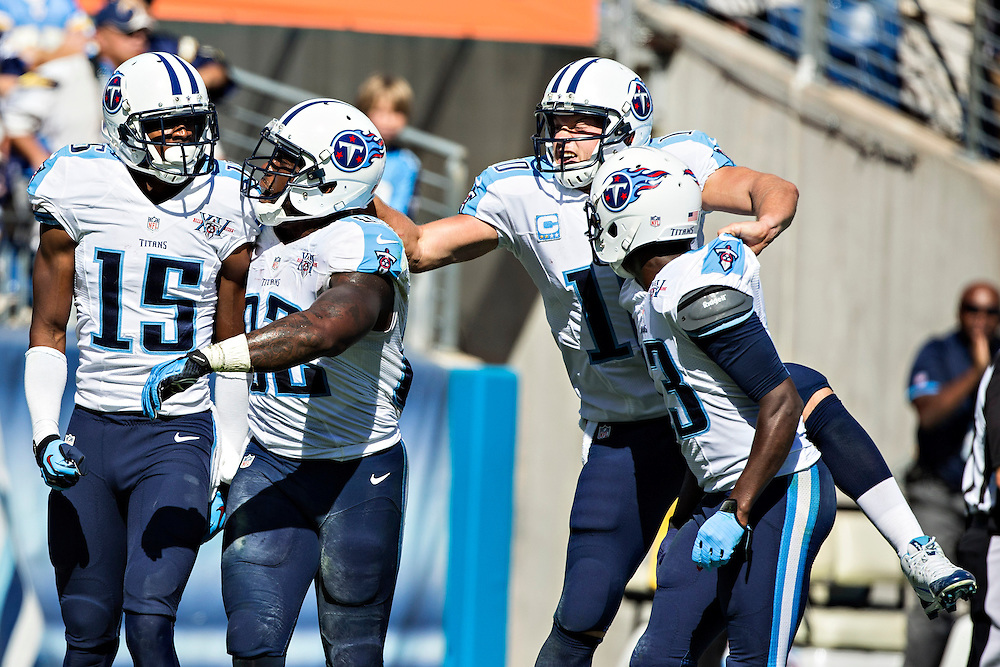 NASHVILLE, TN - SEPTEMBER 22:  Justin Hunter #15 of the Tennessee Titans celebrates with teammates Delanie Walker #82 and Jake Locker #10 after catching the game winning touchdown pass against the San Diego Chargers at LP Field on September 22, 2013 in Nashville, Tennessee.  The Titans defeated the Chargers 20-17.  (Photo by Wesley Hitt/Getty Images) *** Local Caption *** Justin Hunter; Delanie Walker; Jake Locker
