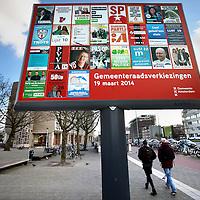 Nederland: Amsterdam; 21 februari 2014.<br /> Verkiezingsbord aan de Wibautstraat in aanloop naar de Gemeenteraadsverkiezingen op 19 maart.<br /> Foto:Jean-Pierre Jans