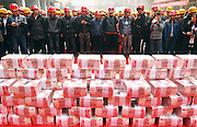 XI\'AN, CHINA - <br /> <br /> Migrant Workers Receive 1.75 million USD Cash At Construction Site <br /> <br /> Migrant workers receive salary and bonus at the construction site on January 18, 2017 in Xi\'an, Shaanxi Province of China. 12 million yuan (about 1.75 million USD) cash has been given out to more than 300 migrant workers as salary and bonus at the construction site on Wednesday ahead of the Spring Festival in Xi\'an. <br /> ©Exclusivepix Media
