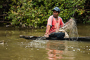 Amerinidian Fisherman<br /> Essequibo River<br /> Iwokrama Forest Reserve<br /> GUYANA<br /> South America