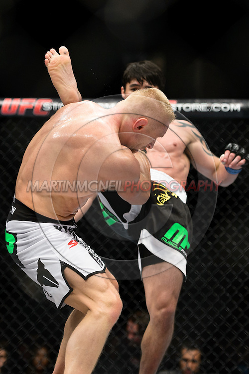 "STOCKHOLM, SWEDEN, APRIL 14:  Dennis Siver (black waistband) and Diego Nunes (white waistband) during ""UFC on Fuel TV: Gustafsson vs. Silva"" inside the Ericsson Globe Arena in Stockholm, Sweden"