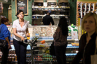 9 July, 2008. New York, NY. Customers shop at the shucking station of the new Whole Foods that opened in Tribeca on July 9th, 2008. The shucking station for oysters and clams is a new feature of the Whole Foods Market.<br /> <br /> ©2008 Gianni Cipriano for The New York Times<br /> cell. +1 646 465 2168 (USA)<br /> cell. +1 328 567 7923 (Italy)<br /> gianni@giannicipriano.com<br /> www.giannicipriano.com