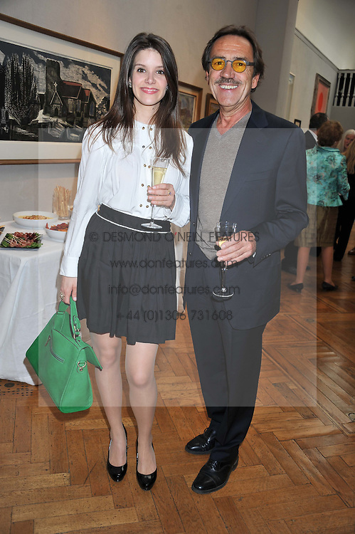 SONYA CASSIDY and ROBERT LINDSAY at a reception to unveil the Limited Centenary Edition of Sir George Frampton's statuette of Peter Pan in aid of the Moat Brae Charity held at The Fine Art Society, 148 New Bond Street, London on 1st May 2012.