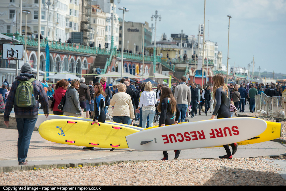 © Licensed to London News Pictures. 18/04/2014. Brighton, UK. People carry surf boards.  People enjoy the  bank holiday sunshine at Brighton today 18th April 2014. Photo credit : Stephen Simpson/LNP