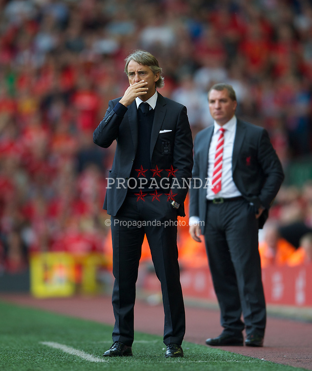 LIVERPOOL, ENGLAND - Sunday, August 26, 2012: Manchester City's manager Roberto Mancini and Liverpool's manager Brendan Rodgers during the Premiership match at Anfield. (Pic by David Rawcliffe/Propaganda)