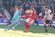 Simon Sluga (12) gathers ahead of Lewis Grabban during the EFL Sky Bet Championship match between Nottingham Forest and Luton Town at the City Ground, Nottingham, England on 19 January 2020.