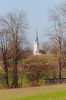 The church in Berikon, Switzerland, seen from below the wooded hill.