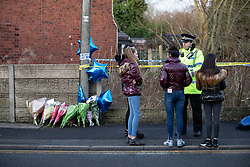 © Licensed to London News Pictures . 29/12/2018 . Wigan , UK . Tributes left at the scene where police have taped off a stretch of Bickershaw Lane in Abram . GMP report they have arrested two people on suspicion of attempted murder and for conspiracy to commit attempted murder , respectively , after a 21-year-old man , identified locally as Billy Livesley , sustained life-threatening injuries yesterday evening (Friday 28th December 2018) . Photo credit : Joel Goodman/LNP