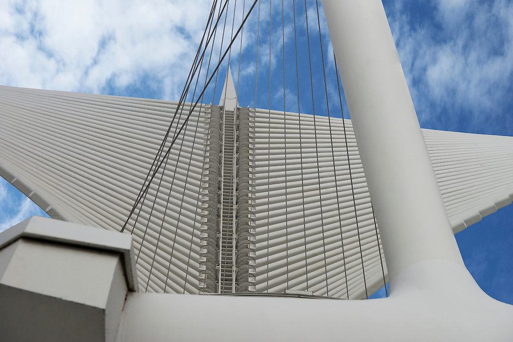 The Burke Brise Soleil is the 217 foot wingspan which is connected to the Milwaukee Art Museum on Lake Michigan.  The sunscreen wings unfold and fold twice a day.  If wind speeds reach 23 mph or greater the sunscreen wings will close automatically.