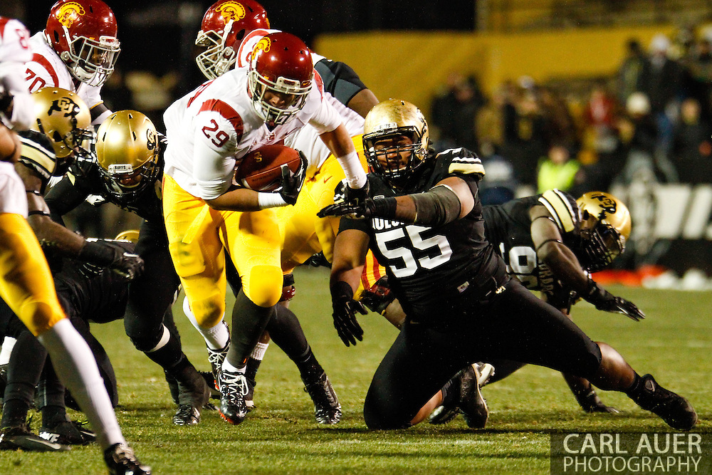 November 23rd, 2013:  USC Trojans freshman running back Ty Isaac (29) runs the ball through the Colorado defense in the second half of the NCAA Football game between the University of Southern California Trojans and the University of Colorado Buffaloes at Folsom Field in Boulder, Colorado