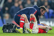 Arsenal defender Shkodran Mustafi (20) on the ground receiving medical attention following a challenge during the Premier League match between Chelsea and Arsenal at Stamford Bridge, London, England on 21 January 2020.