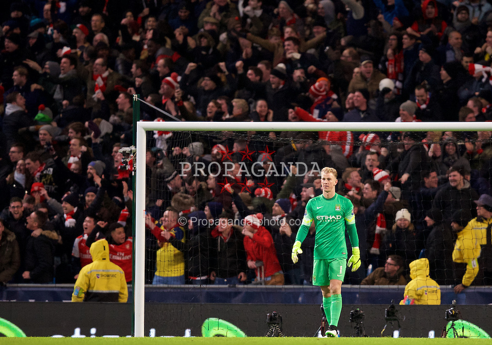 MANCHESTER, ENGLAND - Sunday, January 18, 2015: Manchester City's goalkeeper Joe Hart looks dejected as Arsenal score the second goal during the Premier League match at the City of Manchester Stadium. (Pic by David Rawcliffe/Propaganda)
