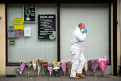 © Licensed to London News Pictures. 11/10/2015. London, UK. A police forensics officer at the scene outside the RE bar in Field End Road, Eastcote, Hillingdon where a man was stabbed to death early this morning (SUN). The victim is believed to be  21-year-old Josh Hanson from Kingsbury.  Photo credit: Ben Cawthra/LNP