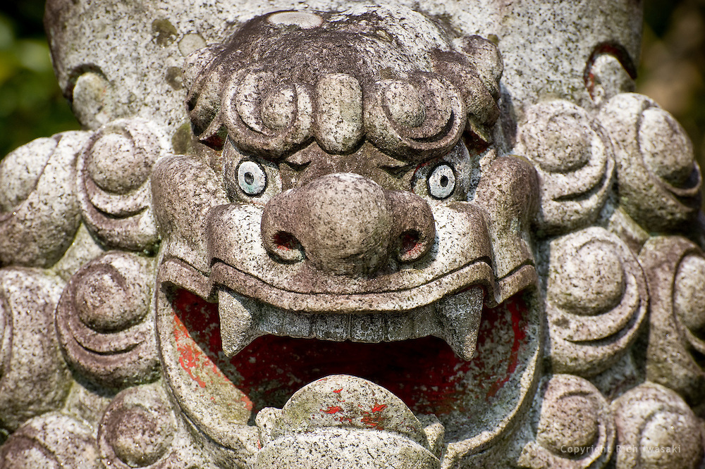 Close-up view of stone lion at Sumiyoshi jinja (shrine) in Saiki, Oita Prefecture, Japan