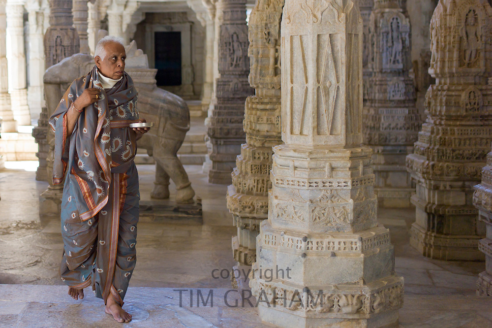 Jain pilgrim, with traditional mask removed, at The Ranakpur Jain Temple at Desuri Tehsil in Pali District, Rajasthan, India