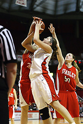 28 January 2007: Nicolle Lewis  gets jammed, Amy Peters in rear. Before a record crowd or nearly 4200, the Bradley Braves were defeated by the conference leading (9-0) Redbirds of Illinois State University by a score of 55-47 at Redbird Arena in Normal Illinois.