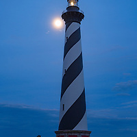 Full moon rising behind the Cape Hatteras Lighthouse. Cape Hatteras National Seashore, NC