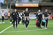 Milton Keynes Dons players and manager arriving during the EFL Sky Bet League 1 match between AFC Wimbledon and Milton Keynes Dons at the Cherry Red Records Stadium, Kingston, England on 22 September 2017. Photo by Matthew Redman.