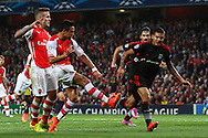 Alexis Sanchez of Arsenal (front) scores the opening goal against Besiktas J.K. during the UEFA Champions League match at the Emirates Stadium, London<br /> Picture by David Horn/Focus Images Ltd +44 7545 970036<br /> 27/08/2014