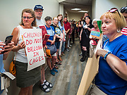 02 JULY 2019 - DES MOINES, IOWA: Protesters line the hallway in front of the office of Rep. Cindy Axne (D-IA). About 150 people came to Congresswoman Axne's office in Des Moines Tuesday to protest the treatment of migrant children detained by the US Border Patrol along the US/Mexico border. Axne was not in the office, but a member of Axne's staff took notes and promised to pass people's concerns on to the Congresswoman. Similar protests were held at other congressional offices and Immigration and Customs Enforcement (ICE) detention facilities across the country.         PHOTO BY JACK KURTZ