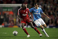 Photo: Paul Thomas.<br /> Liverpool v PSV Eindhoven. UEFA Champions League. Quarter Final, 2nd Leg. 11/04/2007.<br /> <br /> Phillip Cocu (R) tries to get Momo Sissoko of Liverpool.
