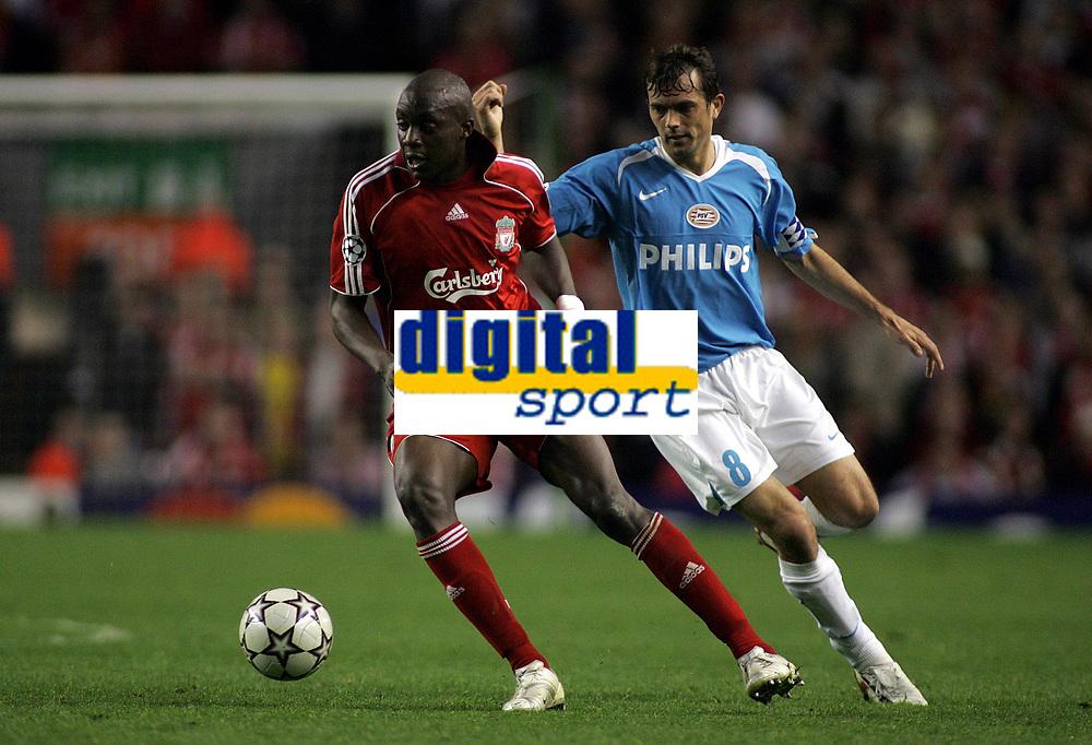 Photo: Paul Thomas.<br /> Liverpool v PSV Eindhoven. UEFA Champions League. Quarter Final, 2nd Leg. 11/04/2007.<br /> <br /> Phillip Cocu (R) tries to get Momo Sissoko of Liverpool.