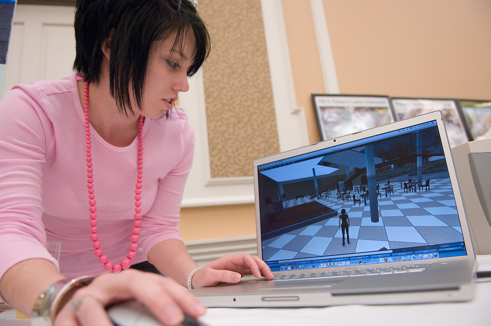 "Meghan Louttit, demonstrates Ohio University's Campus on Second Life..Ist Annual Outreach Expo..Celebrate teaching, research and service in Appalachian Ohio.Two-day event showcases Ohio University partnerships throughout the region.ATHENS, Ohio (April 3, 2007) -- Ohio University stands out for its deep commitment to serve local and regional communities around it. At an upcoming expo and conference, learn about the wide-ranging community partnerships and the impact they are making every day...The Office for University Outreach event, held April 13 to 14 in the Baker University Center Ballroom, will encourage university and local community members to explore existing partnerships and create new ones...On Friday, April 13, the Outreach EXPO will showcase the work of more than 50 exhibitors with relationships in the region. Groups such as Kids on Campus and African Americans in the Ohio River Valley as well as individual researchers from Athens and regional campuses will share posters. Athens group Rattletrap Stringband, which calls itself a ""blues, ragtime, hillbilly"" band, will add local color to the event...Emphasizing the focus on Appalachia, ""Grandmother of Appalachian Studies"" Helen Lewis will present a keynote lecture Friday evening. Lewis is past president of the national organization Appalachian Studies Association and has taught at more than half a dozen Appalachian colleges and universities...The event continues on Saturday, April 14, with the conference ""A Celebration of Teaching, Research and Service in Appalachian Ohio."" It will include panels about education, research and service in Appalachia as well as a brainstorming session about a potential Ohio University Appalachian studies program...Faculty, staff, students and community members are encouraged to attend the event. Attendees must RSVP for Saturday's conference by e-mailing outreach@ohio.edu by Friday, April 6. For more information and a schedule, visit www.outreach.ohio.edu/events.htm."