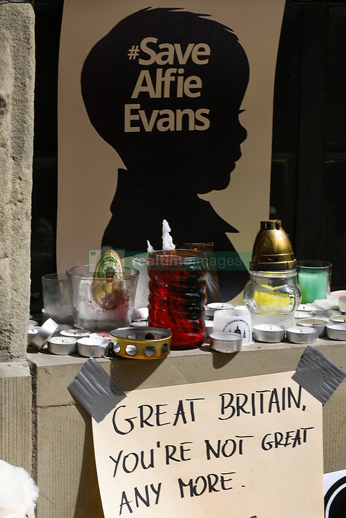 April 27, 2018 - Krakow, Poland - Candles seen in tribute for the life of Alfie Evans during  a rally organized by a conservative nationalist association in front of the consulate of Great Britain in Krakow. Alfie Evans is a 2 years old young boy, with a serious undiagnosed brain condition. The Italian government has granted Alfie Evans an Italian citizenship to bring him to Italy but the British courts have refused to allow the child, who still continues to fight after being taken off life support earlier this week, to be transferred to Italy. (Credit Image: © Omar Marques/SOPA Images via ZUMA Wire)
