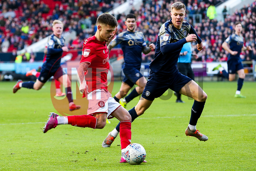 Jamie Paterson of Bristol City is challenged by Mads Juel Andersen of Barnsley - Rogan/JMP - 18/01/2020 - Ashton Gate Stadium - Bristol, England - Bristol City v Barnsley - Sky Bet Championship.