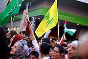 Mainz | 18 July 2014<br /> <br /> Am Samstag (18.07.2014) nahmen etwa 1000 M&auml;nner, Frauen und Kinder in der Innenstadt von Mainz anl&auml;sslich der milit&auml;rischen Auseinandersetzung zwischen Israel und der Hamas in Gaza an einer Solidarit&auml;tsdemonstration f&uuml;r Gaza, ein freies Pal&auml;stina und gegen Israel teil. Bei der Demo wurden Fahnen der Hamas und der Hisbollah mitgef&uuml;hrt, neben den &uuml;blichen Parolen gegen Israel wurde in Sprechch&ouml;hren auch vereinzelt zur Vernichtung von J&uuml;dinnen und Juden aufgerufen.<br /> Hier: Mitten in der Demo die gelbe Fahne der Hisbollah.<br /> <br /> <br /> &copy;peter-juelich.com<br /> <br /> [No Model Release | No Property Release]