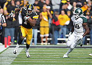 November 12, 2011: Iowa Hawkeyes wide receiver Marvin McNutt (7) tries to avoid Michigan State Spartans linebacker Chris Norman (10) after a catch during the first half of the NCAA football game between the Michigan State Spartans and the Iowa Hawkeyes at Kinnick Stadium in Iowa City, Iowa on Saturday, November 12, 2011. Michigan State defeated Iowa 37-21.