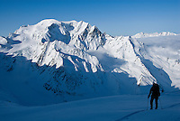 A skier climbs toward the Plateau du Couloir along the classic Haute Route in Switzerland.