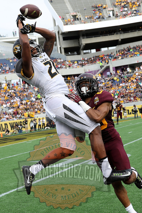 ORLANDO, FL - JANUARY 01:  Bud Sasser #21 of the Missouri Tigers attempts a catch during the Buffalo Wild Wings Citrus Bowl between the Minnesota Golden Gophers and the Missouri Tigers at the Florida Citrus Bowl on January 1, 2015 in Orlando, Florida. (Photo by Alex Menendez/Getty Images) *** Local Caption *** Bud Sasser