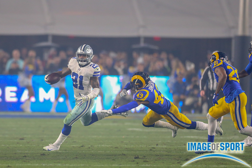 Jan 12, 2019; Los Angeles, CA, USA;  Dallas Cowboys running back Ezekiel Elliott (21) is pursued by Los Angeles safety John Johnson III (43) during an NFL divisional playoff game at the Los Angeles Coliseum. The Rams beat the Cowboys 30-22. (Kim Hukari/Image of Sport)