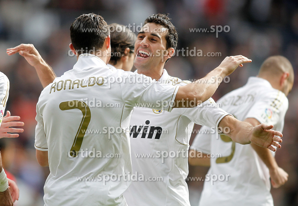06.11.2011, Santiago Bernabeu Stadium, Madrid, ESP, Primera Division, Real Madrid vs CA Osasuna, im Bild  Real Madrid's Cristiano Ronaldo celebrates with Alvaro Arbeloa // during Primera Division league football match between Real Madrid an CA Osasuna at Santiago Bernabeu Stadium, Madrid, Spain on 06/11/2011. EXPA Pictures © 2011, PhotoCredit: EXPA/ Alterphoto/ Alvaro Hernandez +++++ ATTENTION - OUT OF SPAIN/(ESP) and OUT OF SWISS/(SUI) ++++
