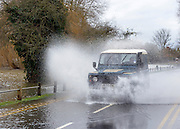 © Licensed to London News Pictures. 29/12/2012. Laleham, UK. A land rover drives along a road next to the flooded River Thames in Laleham.  Flooding along the River Thames today 29th December 2012.Forecasters say the UK can expect heavy rain and winds the coming days. Photo credit : Stephen Simpson/LNP