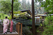 Two ladies in kimonos on the their way up the stairs to the Portland Japanese Garden.<br /> <br /> Photo by Christina Sjogren