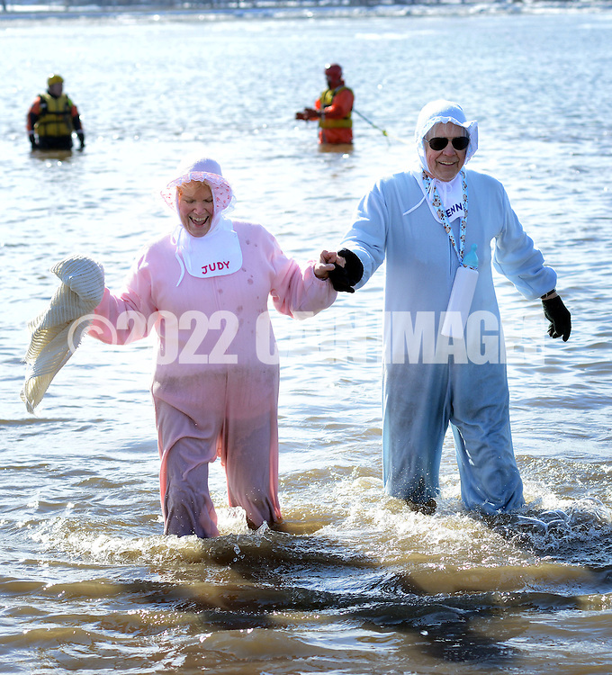 Judy Misoyianis of Vincenttown, New Jersey and Dennis Hart of Philadelphia, Pennsylvania dressed as Baby Boomers exit the 32 degree Delaware River during the eighth annual Eastern Polar Bear Plunge to benefit Special Olympics Pennsylvania (SOPA) Saturday January 30, 2016 at Neshaminy State Park in Bensalem, Pennsylvania. (Photo by William Thomas Cain)
