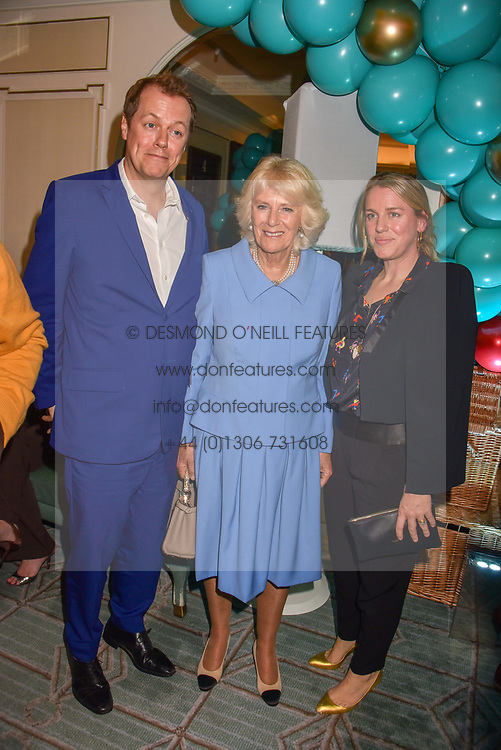 Left to right, Tom Parker Bowles, HRH The Duchess of Cornwall and Laura lopes at the launch of the Fortnum & Mason Christmas & Other Winter Feasts Cook Book by Tom Parker Bowles held at Fortnum & Mason, 181 Piccadilly, London, England. 17 October 2018.