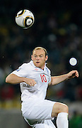 Wayne Rooney (England) heads the ball during the 2010 FIFA World Cup South Africa Group C match between England and USA at the Royal Bafokeng Stadium on June 12, 2010 in Rustenburg, South Africa.