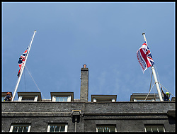 June 19, 2017 - London, London, United Kingdom - Image ©Licensed to i-Images Picture Agency. 19/06/2017. London, United Kingdom. Downing Street Flags at Half Mast...Workers in safety harnesses lower the Union flags over Number 10 Downing Street to half mast in light of last nights terror attack on Finsbury Park Mosque...Picture by Pete Maclaine / i-Images (Credit Image: © Pete Maclaine/i-Images via ZUMA Press)