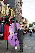 08/09/2014 Repro Free  Finghin Collins, Artistic Director and Beau Holland, stiltwalker at the launch of Music for Galway's 34th International Concert Season.  <br /> Picture:Andrew Downes