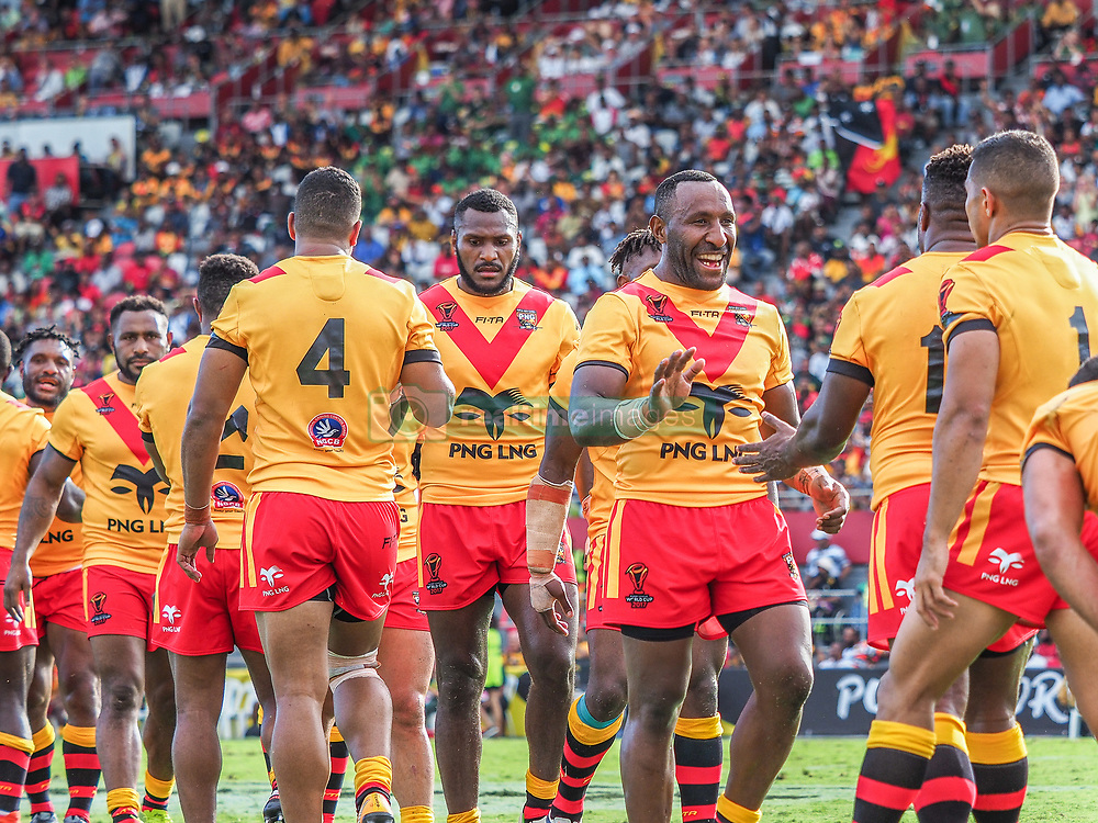 Handout photo dated 28/10/17 provided by NRL Photos of Papua New Guinea players celebrate beating Wales after the Rugby League World Cup, Pool C match at the Oil Search National Football Stadium, Port Moresby.