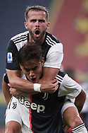 Juventus's Argentinian striker Paulo Dybala celebrates with Bosnian midfielder Miralem Pjanic after scoring to give the side a 1-0 lead during the Serie A match at Luigi Ferraris, Genoa. Picture date: 30th June 2020. Picture credit should read: Jonathan Moscrop/Sportimage
