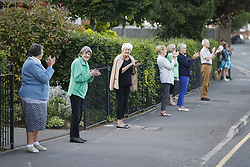© Licensed to London News Pictures. 28/05/2020. Epsom, UK. People join in with Clap for Carers outside Epsom General Hospital in Surrey. The government has announced a new series of measures to slowly ease lockdown, which was introduced to fight the spread of the COVID-19 strain of coronavirus. Photo credit: Peter Macdiarmid/LNP