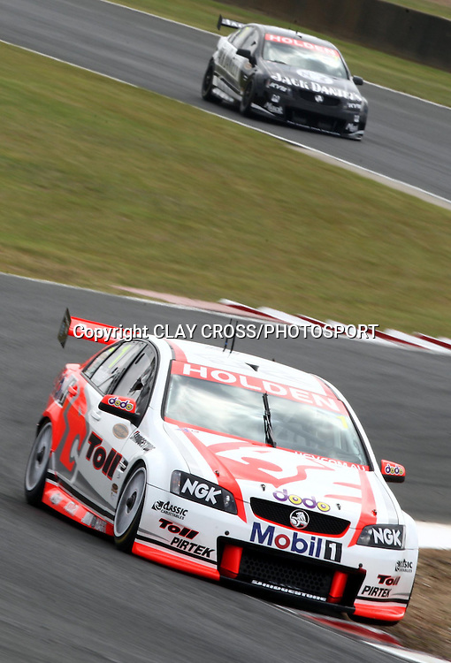Garth Tander driving the Holden Racing Team Holden lead Todd Kelly during the V8 Supercar race at Eastern Creek Raceway, Western Sydney on Saturday 8th March 2008. Photo: Clay Cross/PHOTOSPORT