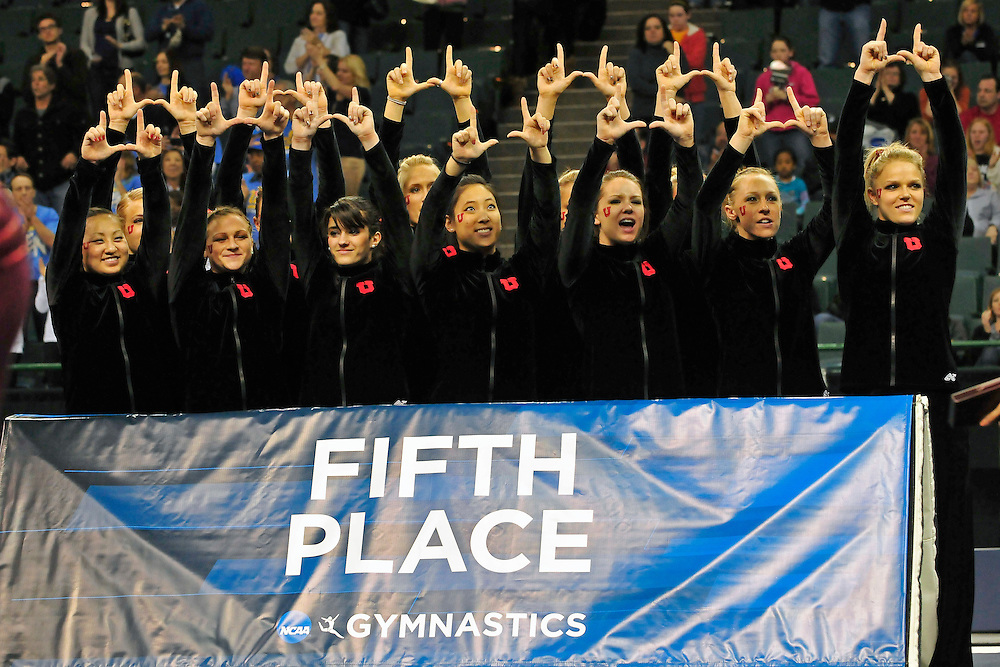 The University of Utah gymnastics team throws up the Ute sign to their fans after finishing fifth over all at the 2011 Women's NCAA Gymnastics Championship Team Finals on April 16, in Cleveland, OH. (photo/Jason Miller)