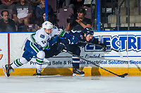 PENTICTON, CANADA - SEPTEMBER 8: Jakob Stukel #34 of Vancouver Canucks checks a player of the Winnipeg Jets into the boards during first period on September 8, 2017 at the South Okanagan Event Centre in Penticton, British Columbia, Canada.  (Photo by Marissa Baecker/Shoot the Breeze)  *** Local Caption ***